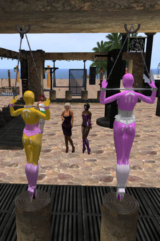 "Enjoying bondage January 2016 at Röpers playground: slaves Nina and FLo looking at their owners Diomita and Jenny. Picture taken from Nina's dA page (sgunjin) ""Night of the Living Latex Dolls"""