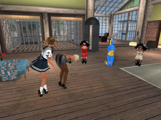 Feb 11th: Angelique smacking her aunt Diomita on the Occasion of her 8th rezzday, the latex slave nuns Flo and Gebby are watching in the background together with living latex doll slave cecy.