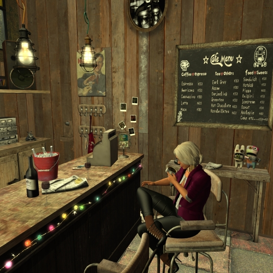 Feb 12th Visiting BarDeco: Diomita drinking a coffee at the BarDeco