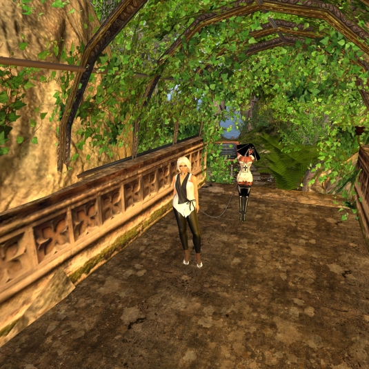 "Feb 25th: Diomita and slave Flo in the tunnel between ""The Garden Conservatory and Spa"" and ""((The Nameless Cafe))"""