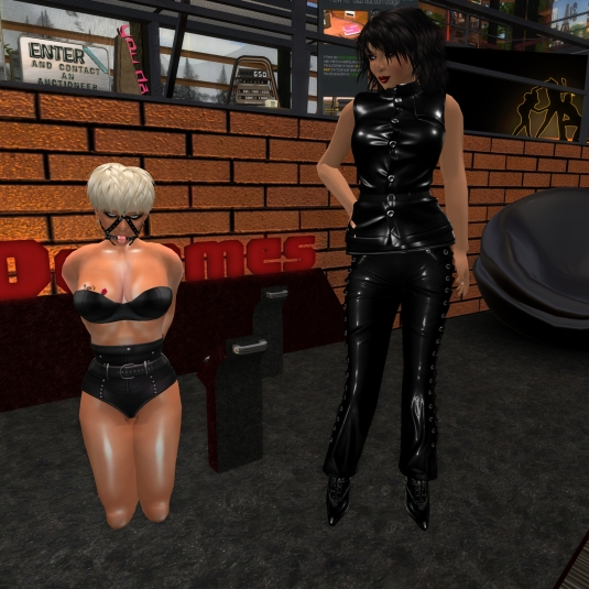 March 20th: Mistress Jenny and Diomita at Domme a Domme in front of the failed domme sign