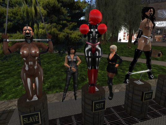 April 13th:  Euro bondage sluts Adarra and Fesselpüppi and slave Flo on the display stand