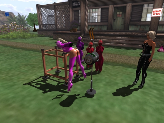 June 7th: slave Adarra on the spanking machine, slaves cecy, Gebby and Flo watching.