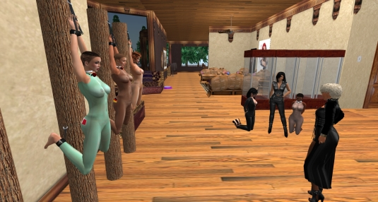 July 18th: slave cecy, sklavin Gebby and slave Pauline tied up at Judies's place. Diomita admires her work. In the Background is Mistress Jenny with slave Flo and Po.