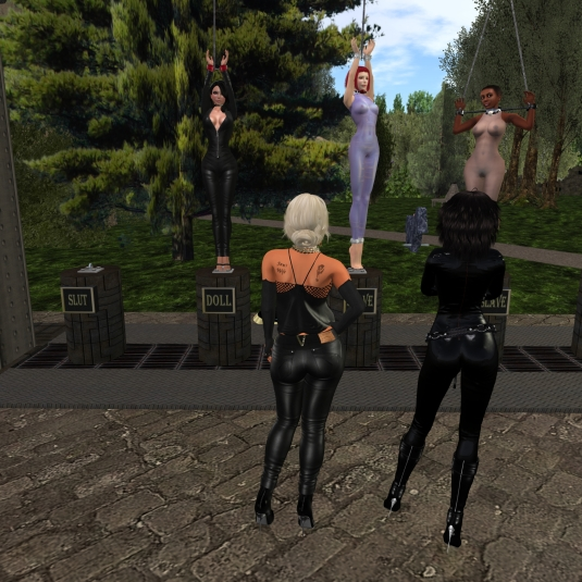 July 31st: Posion, slave Nina and slave Flo exposed at Lochme. Mistress Jenny and I looking at my handiwork. Don't we have just great backsides?