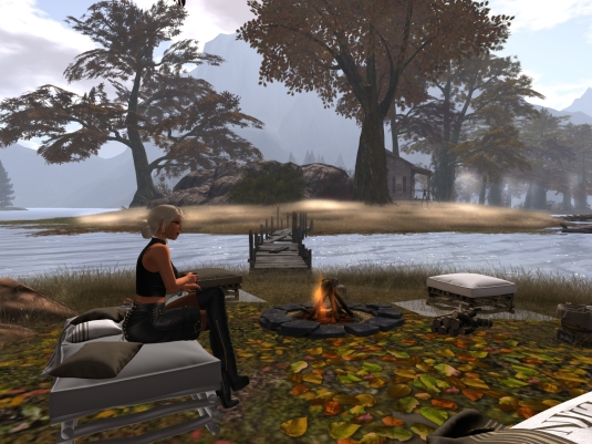 """October 8th: Visiting """"It all starts with a smile"""" again - sitting at the campfire and drinking a coffee"""