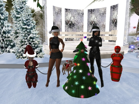 December 4th: slavin C, Diomita, slave D, Mistress Jenny and slave Flo in front of the Christmas gazebo at home