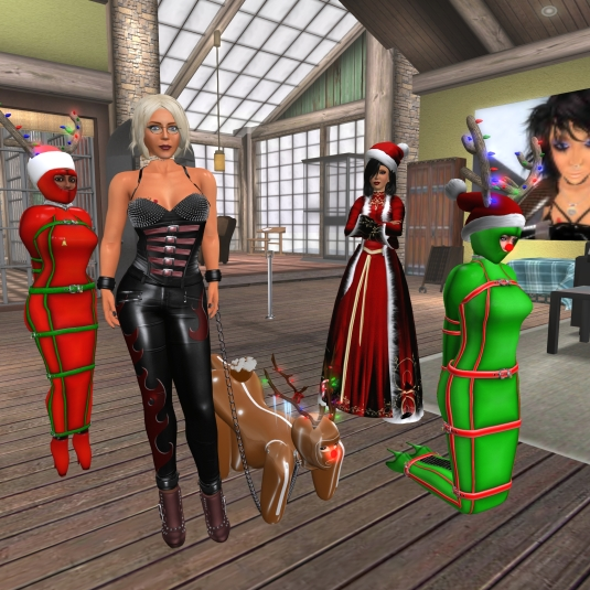 December 20th at home - seasonal spirit in our house: slave Flo, Diomita, slave puppy Adarra, Mistress Jenny and slave cecy