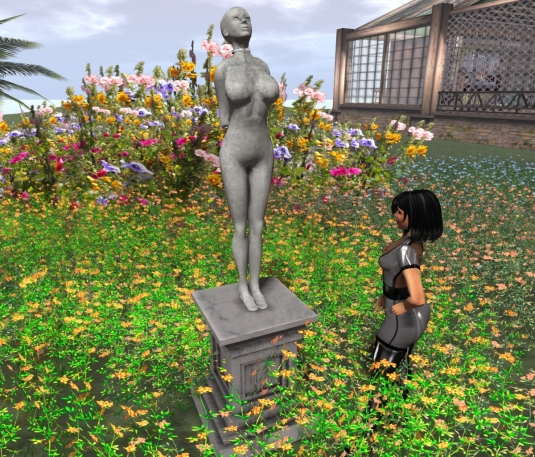 Feb 25th at home: Mistress Jenny  looking at the statue of slave slut cecy (not drippin' anymore btw.)