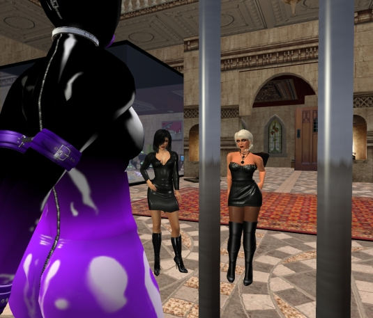 March 4th at Lochme: slut cecy's view from inside the voting cage at Mistress Jenny and Diomita